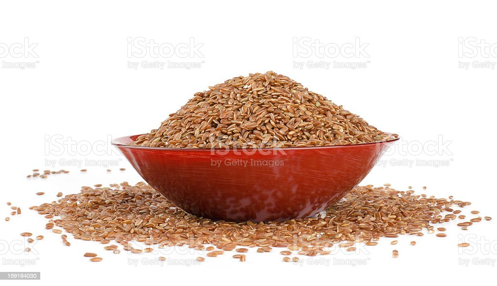 red rice in a brown royalty-free stock photo