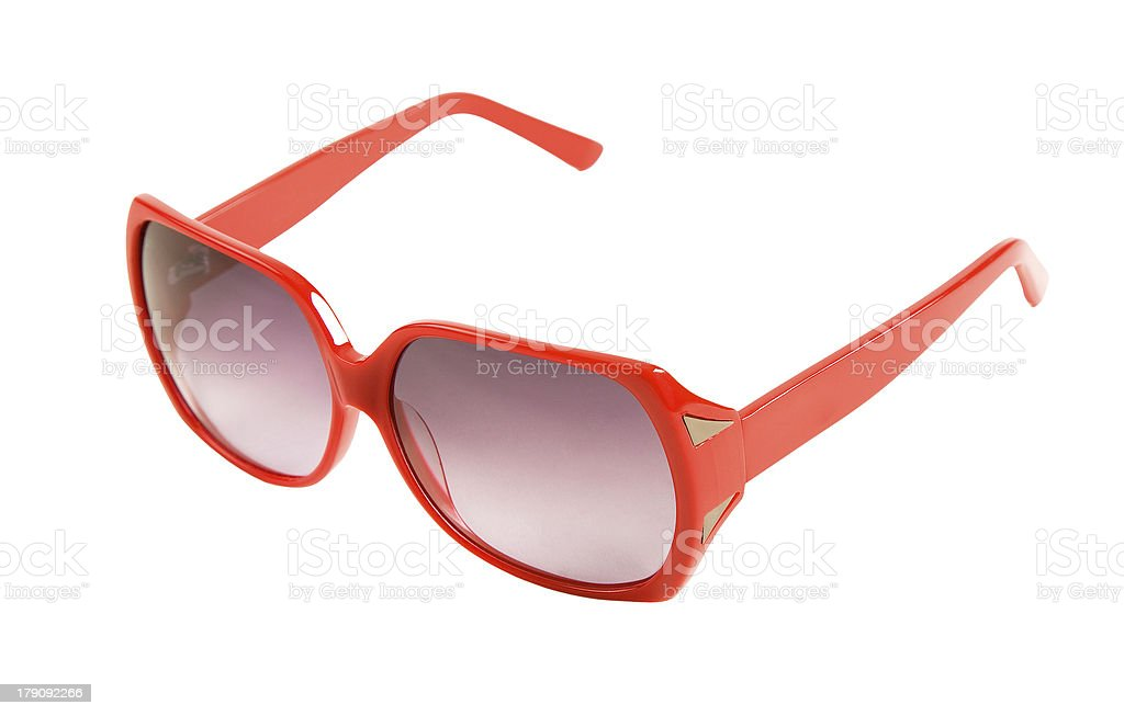 Red rimmed sunglasses with mirror ornaments stock photo