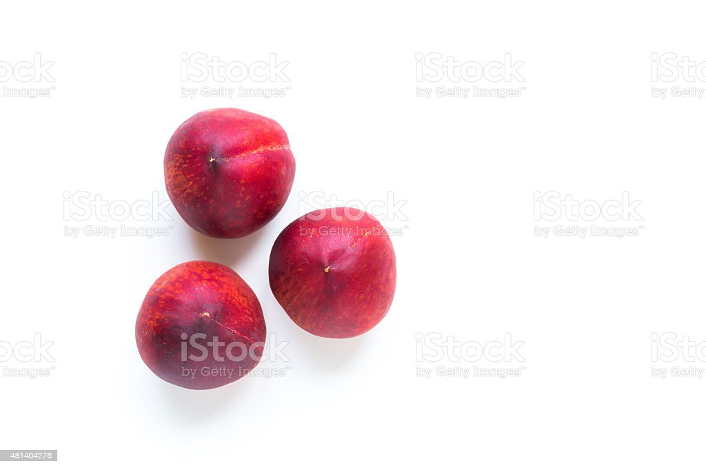 Red ripe peaches fruits isolated on white background stock photo