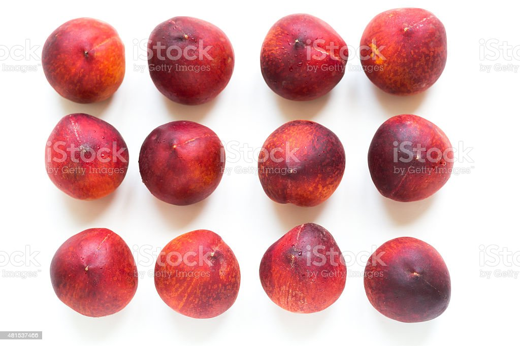 Red ripe peaches isolated on white background stock photo