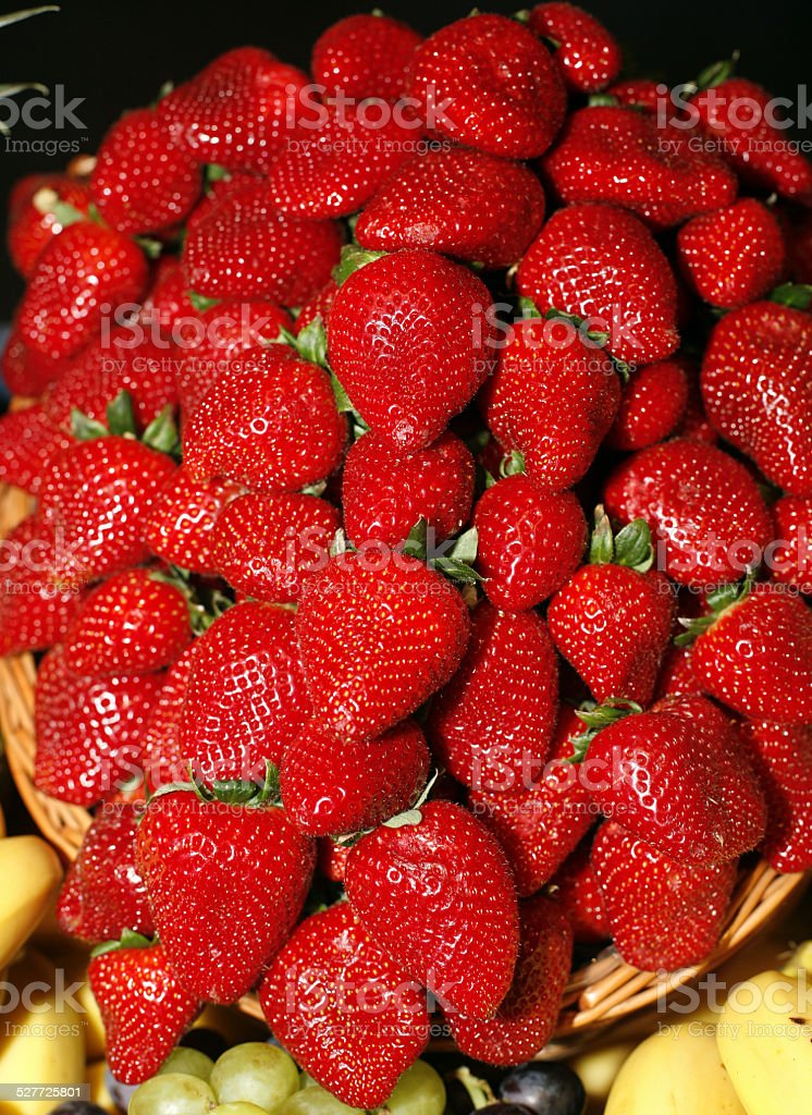 Red ripe strawberries close-up on market stock photo