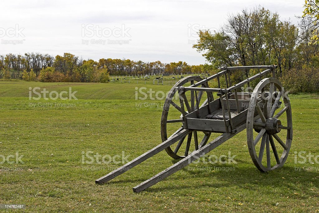 Red River Cart Batoche Cemetery in Background royalty-free stock photo