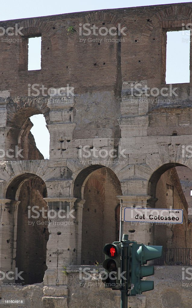 Red road sign semaphore with Piazza del Colosseo in Rome royalty-free stock photo