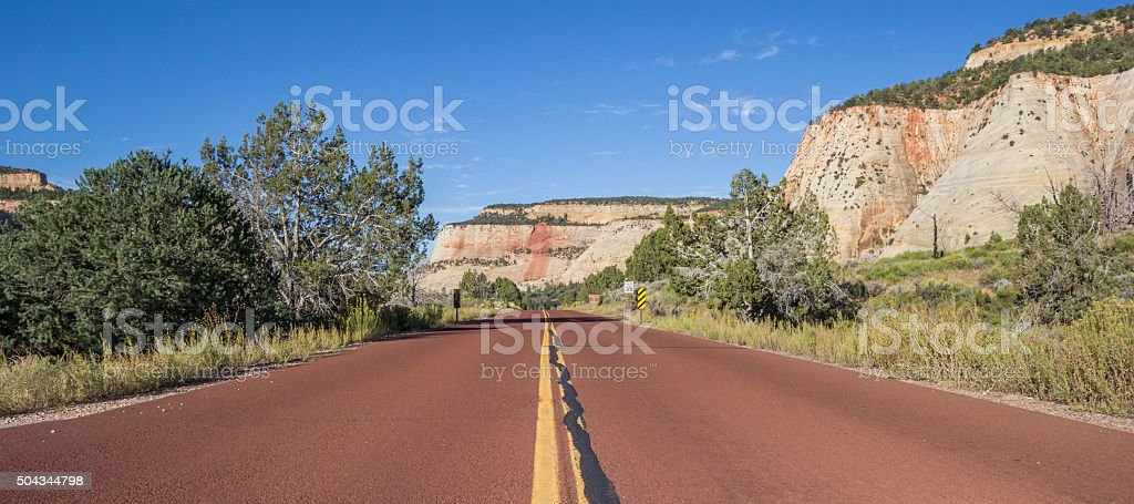 Red road through Zion National Park in Utah stock photo
