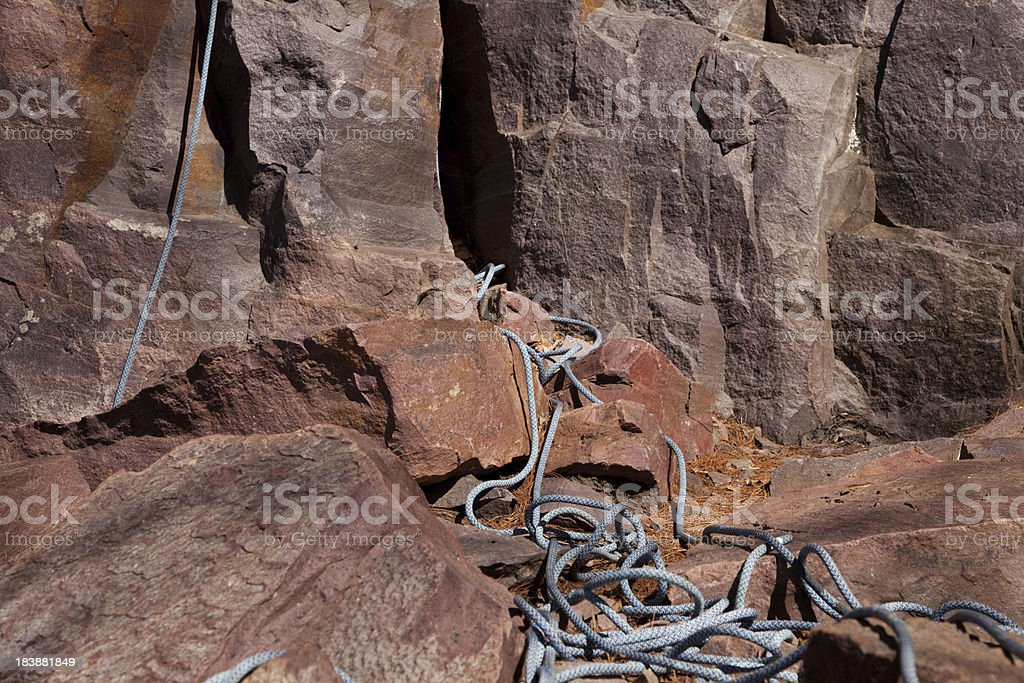 Red rock climbing wall with rope stock photo