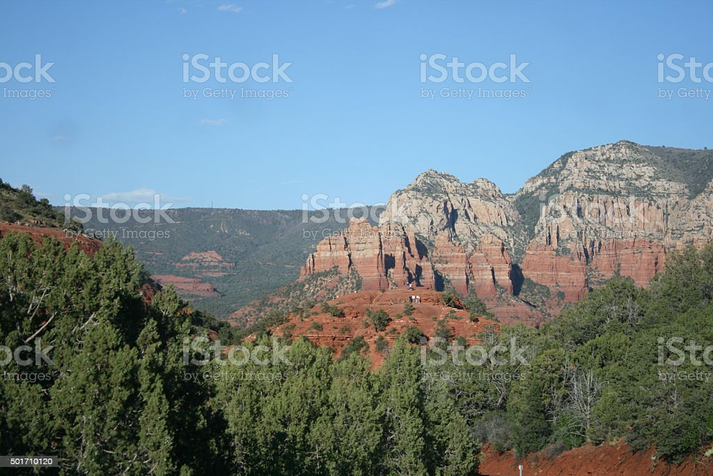 Red rock hills, trees stock photo