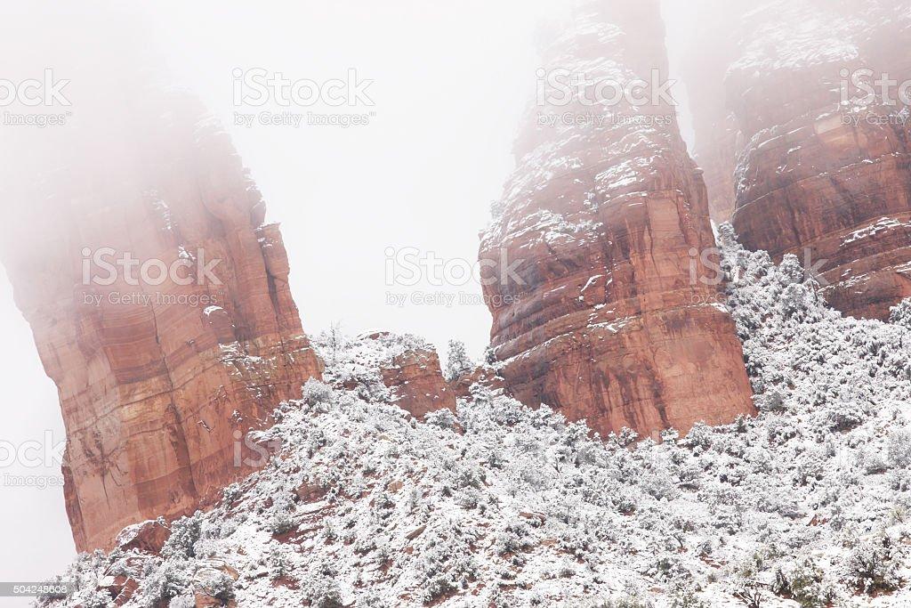 Red Rock Hoodoo Canyon Winter Snow Fog stock photo