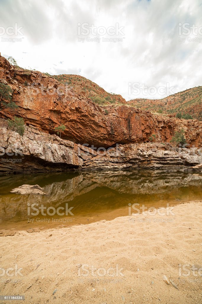 Red rocks and pond in the West McDonnell national park stock photo