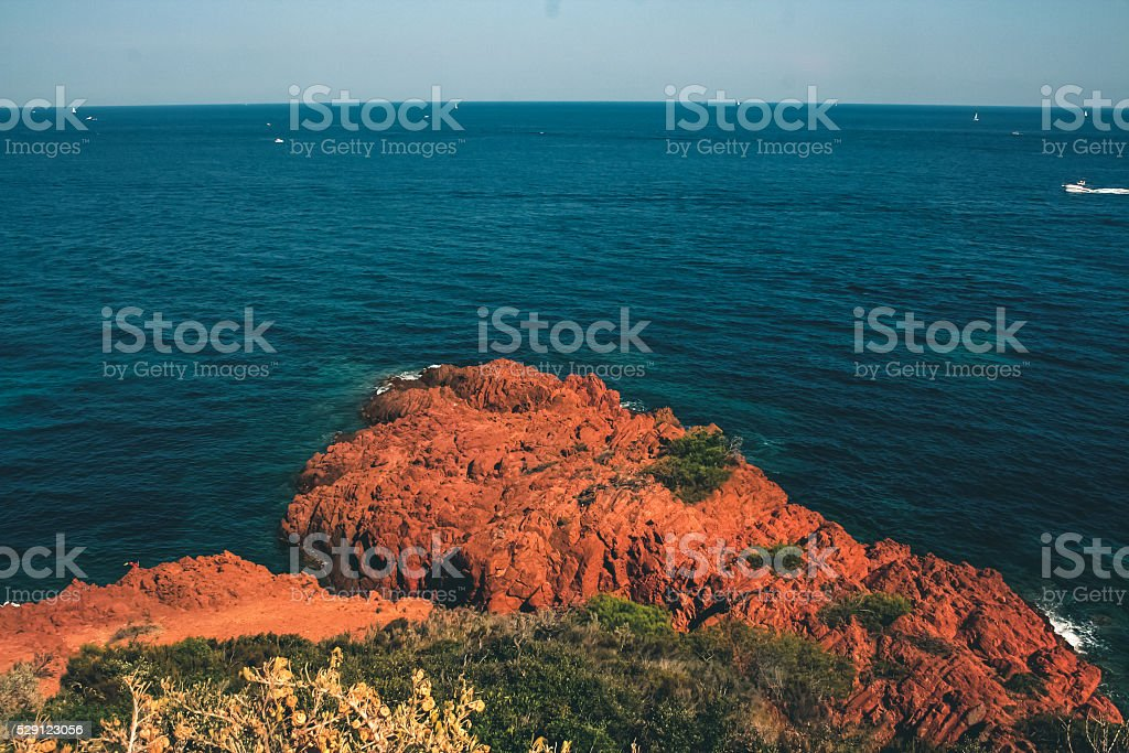 Red rocks by the sea in southern France stock photo