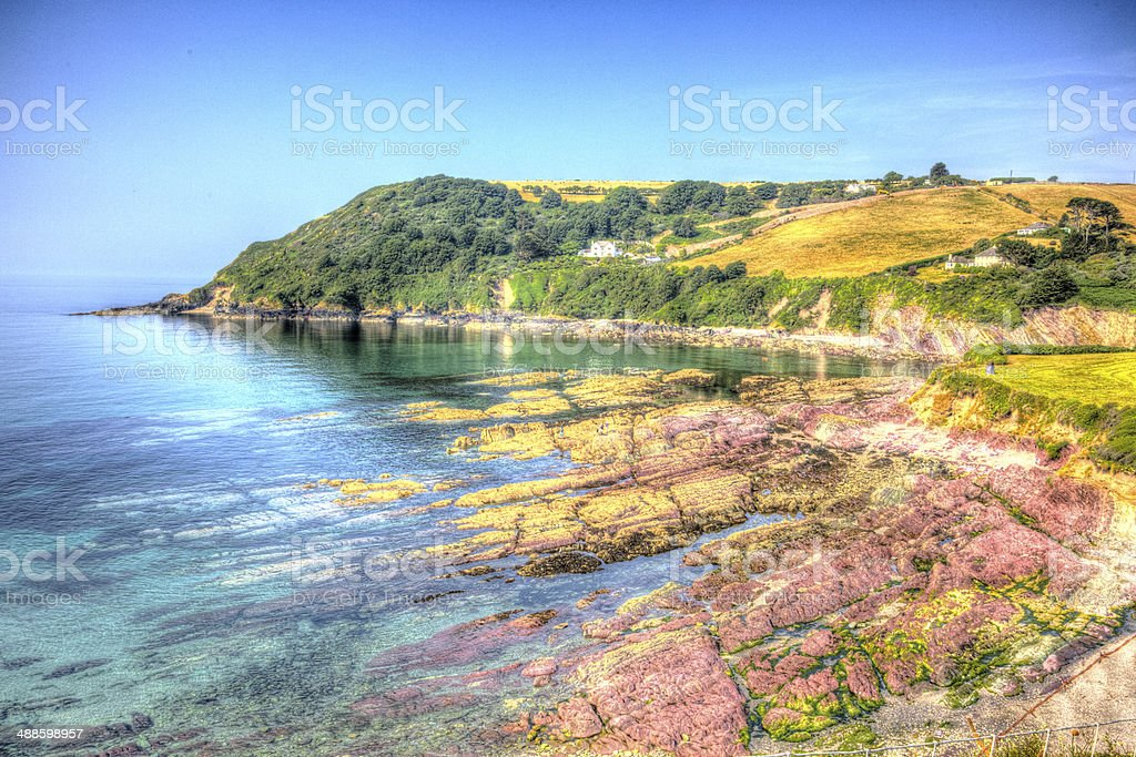 Red rocks Talland Bay Cornwall in colourful HDR stock photo