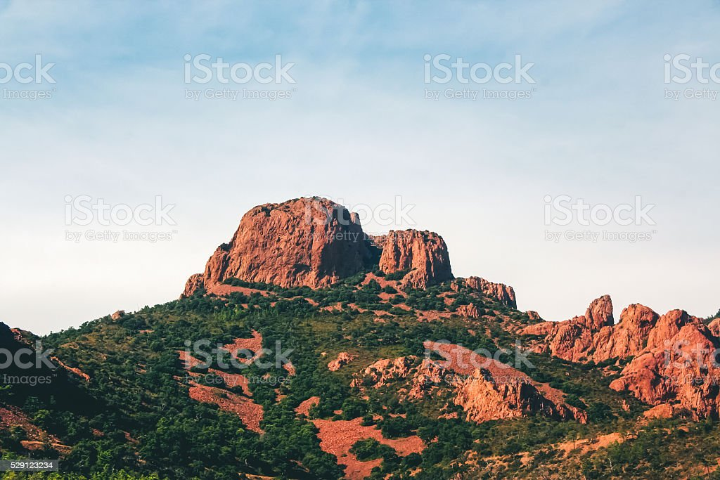 Red rocky mountains in southern France stock photo