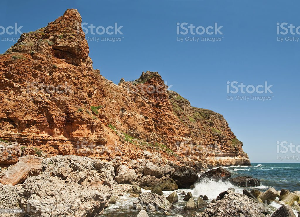 Red rocky seashore stock photo