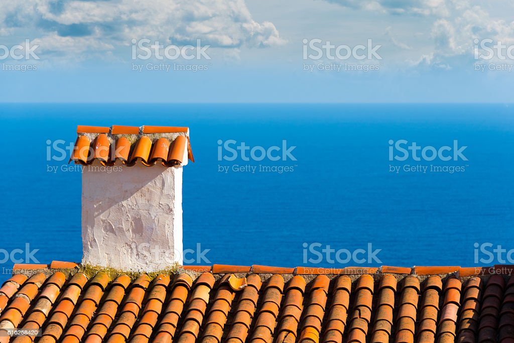 red roof with ocean view stock photo