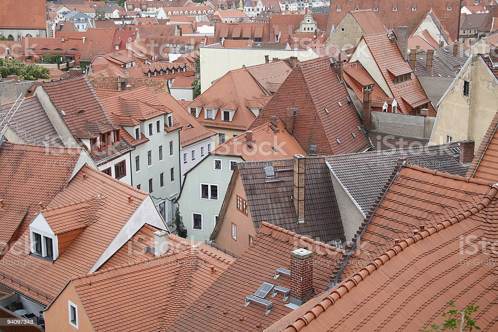 Red roofs and chimneys of a city. stock photo