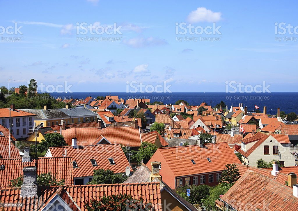 Red roofs and ocean at Gudhjem town in Denmark stock photo