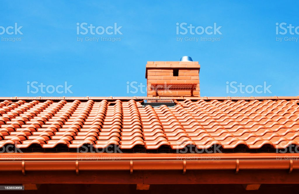 Red rooftop with small chimney royalty-free stock photo
