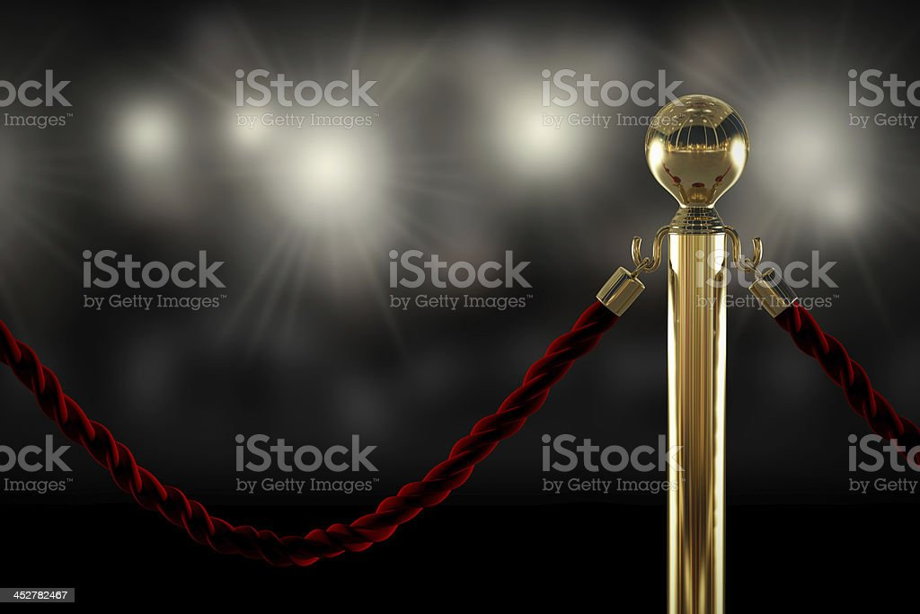 Red rope barrier close-up stock photo