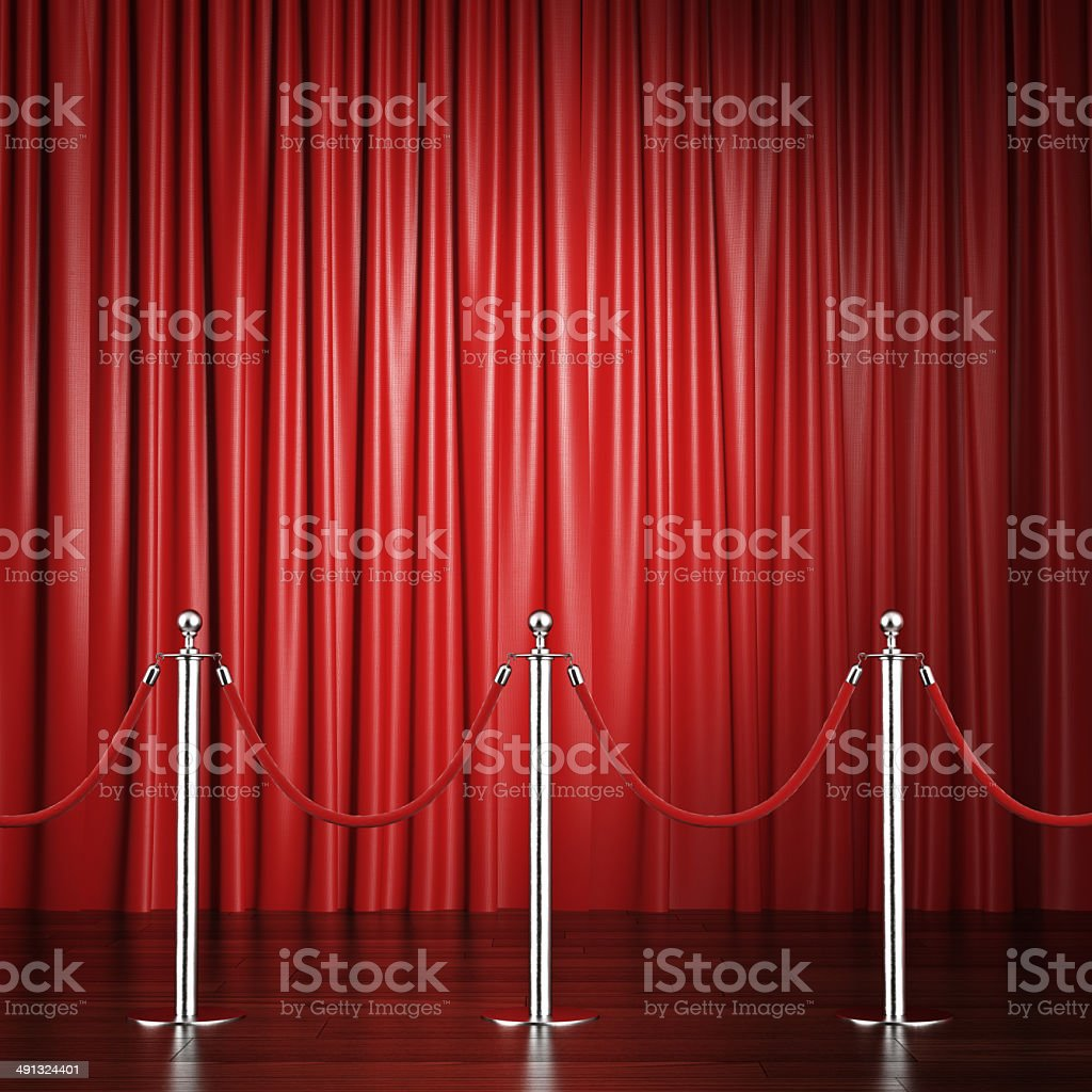 red rope barrier with a curtain stock photo