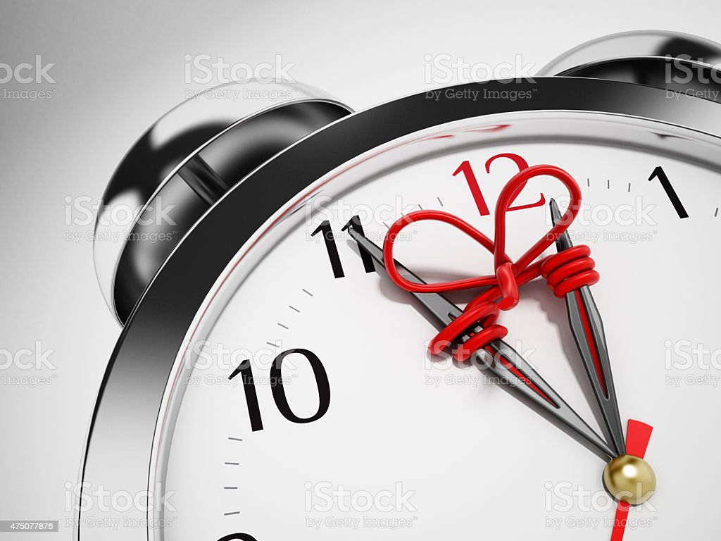 Red rope connecting hour and minute hands of the clock stock photo