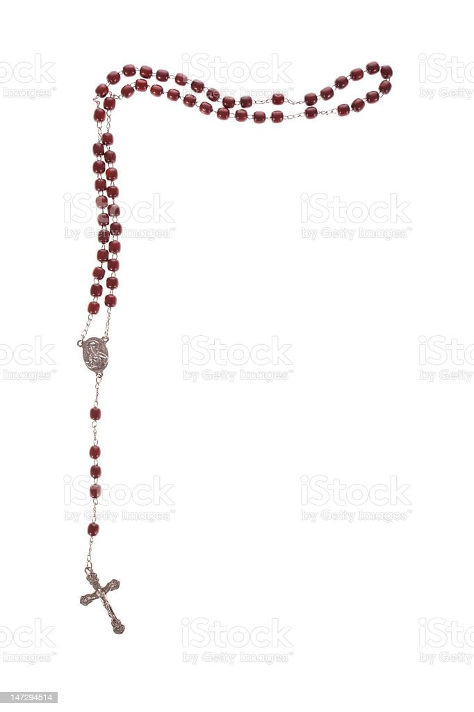 Red rosary beads with a cross on a white background stock photo