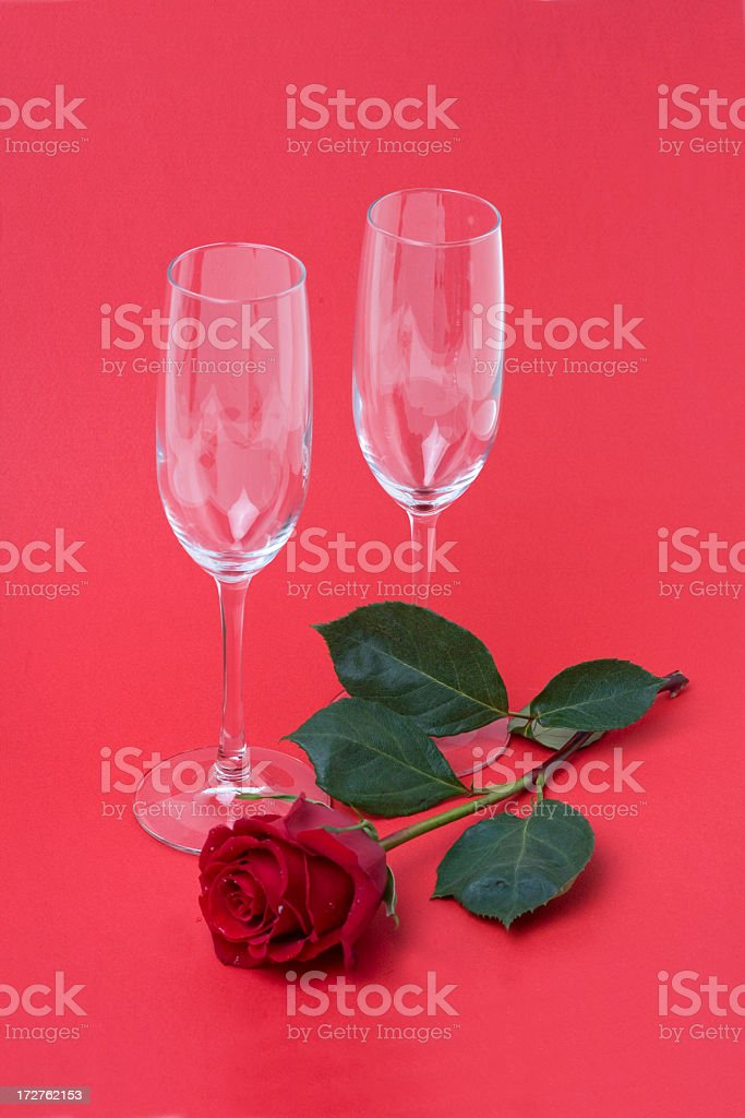 Red rose and two glasses of champagne royalty-free stock photo