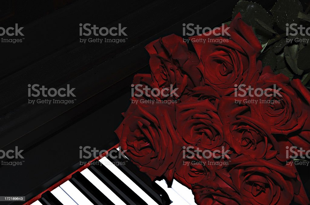 Red Rose Bouquet on Piano royalty-free stock photo