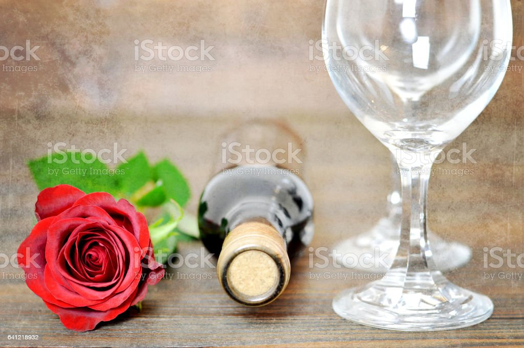 Red rose, wine glasses and bottle of red wine stock photo