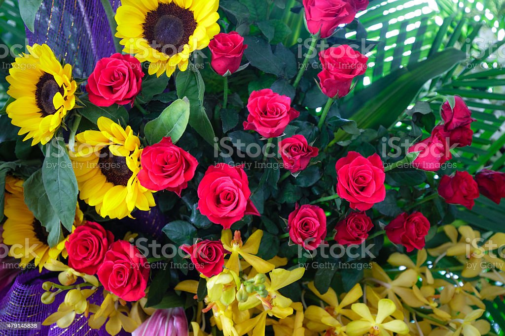 red roses and yellow daisies for the event closeup stock photo