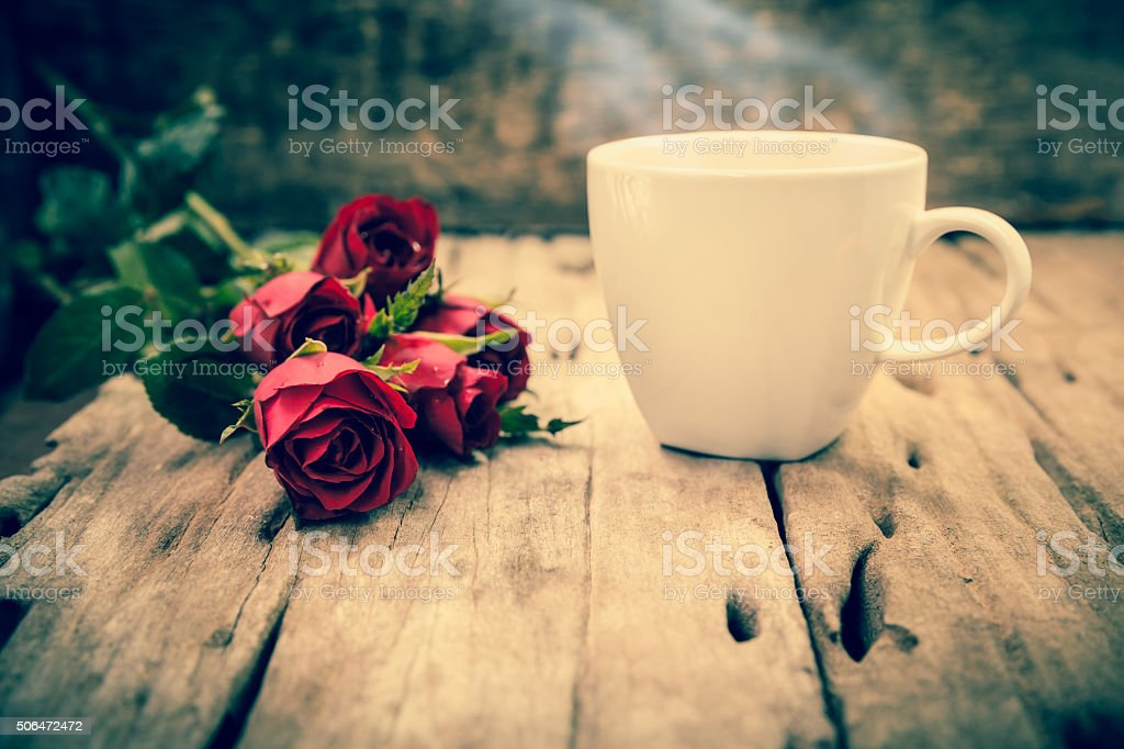 Red roses for Valentine's Day on blurred wooden background.  Cro stock photo