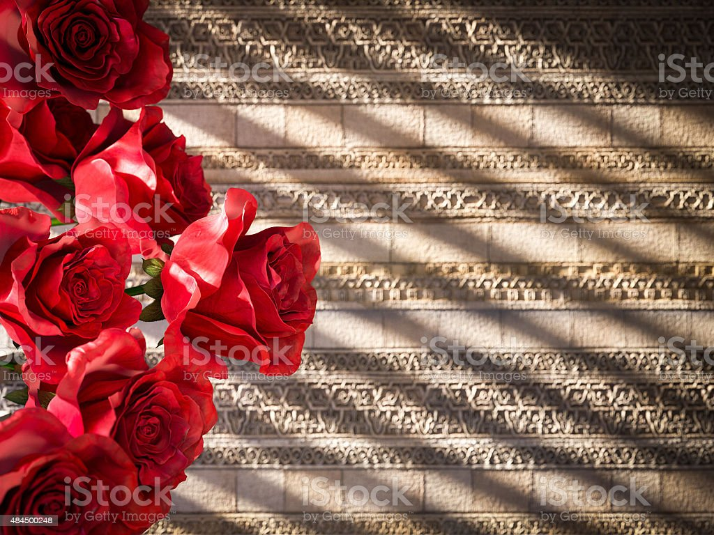 red roses on ancient wall decorative concept background stock photo