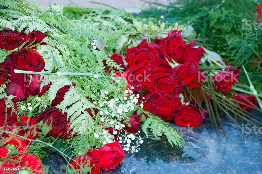Red roses on marble stock photo