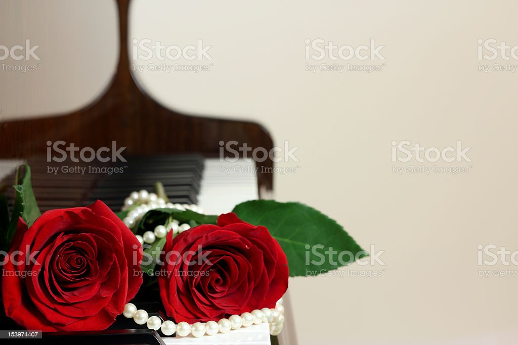 Red Roses on Piano Keyboard stock photo
