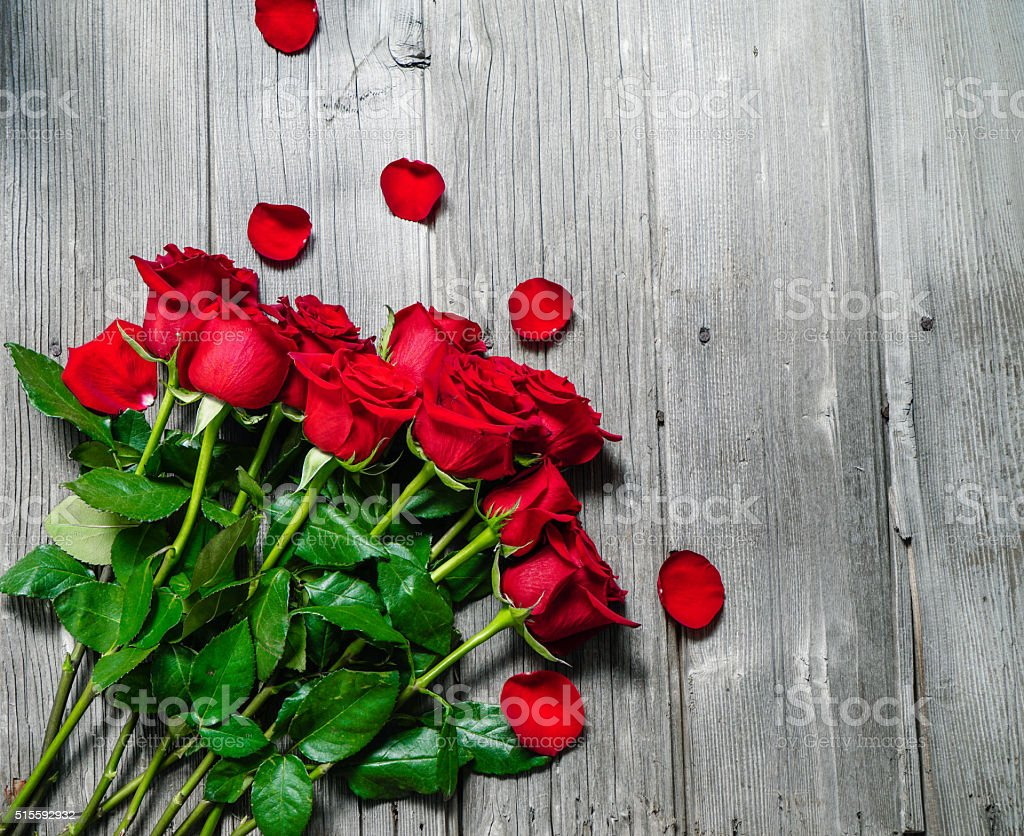 Red Roses on Wood Background. stock photo