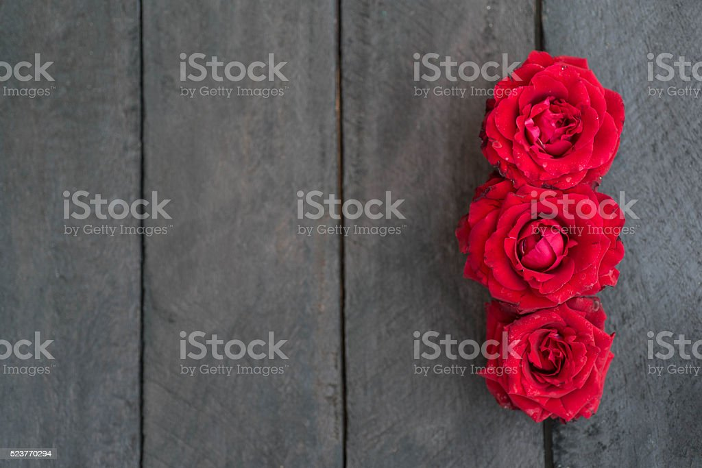 Red roses on wood background,Retro vintage ,Valentines Day stock photo