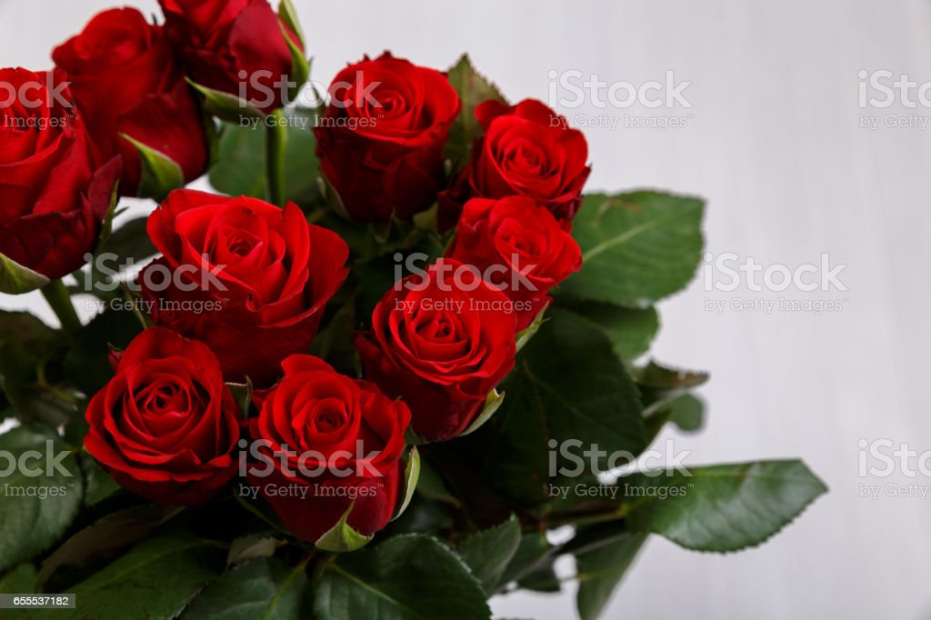 Red roses on wooden background. Love design. stock photo