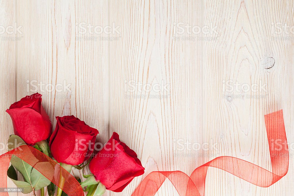 Red roses on wooden background stock photo