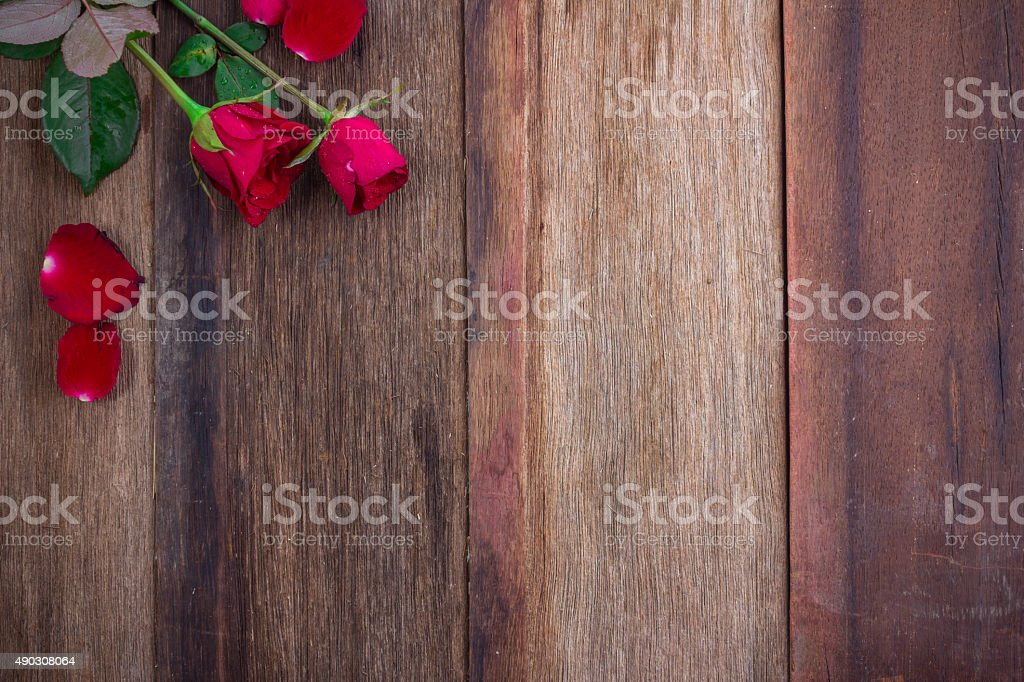 red roses on wooden Board stock photo