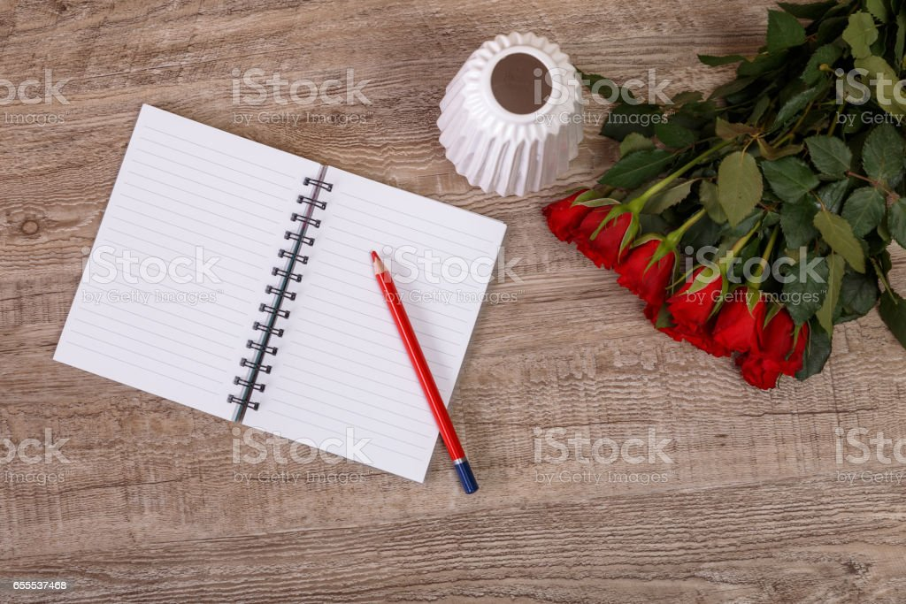 Red roses with pencil and notepad. Love design. stock photo
