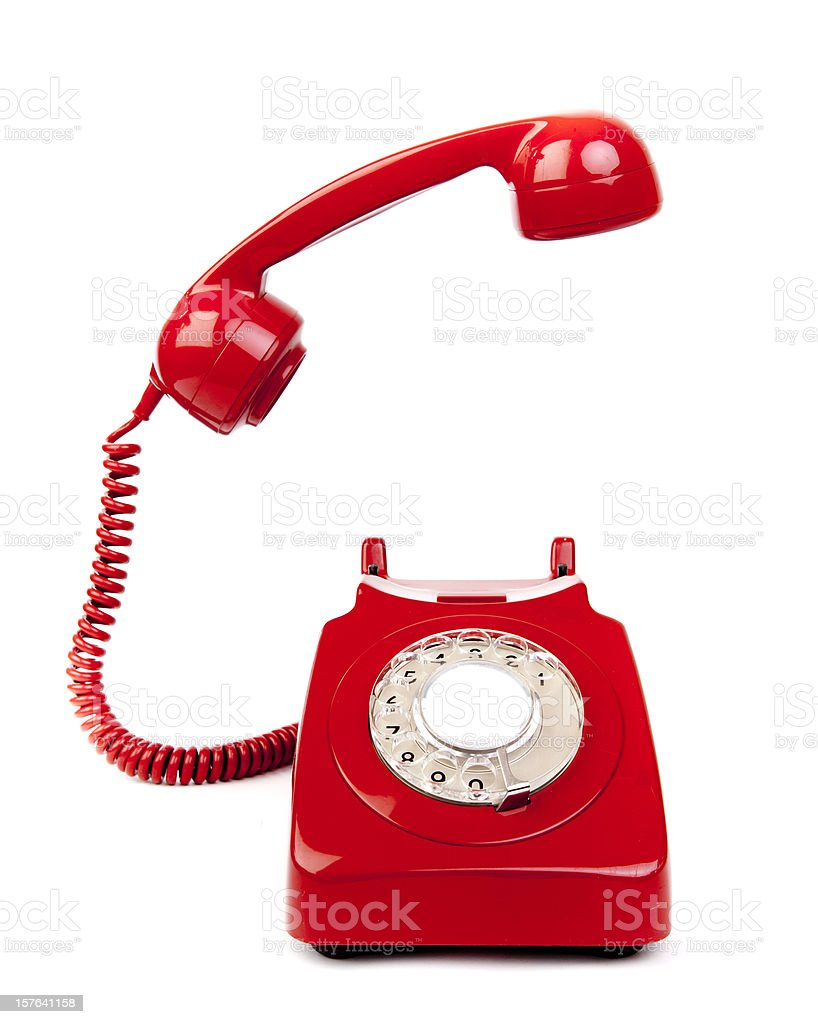 Red rotary dial telephone with cord on white background  stock photo