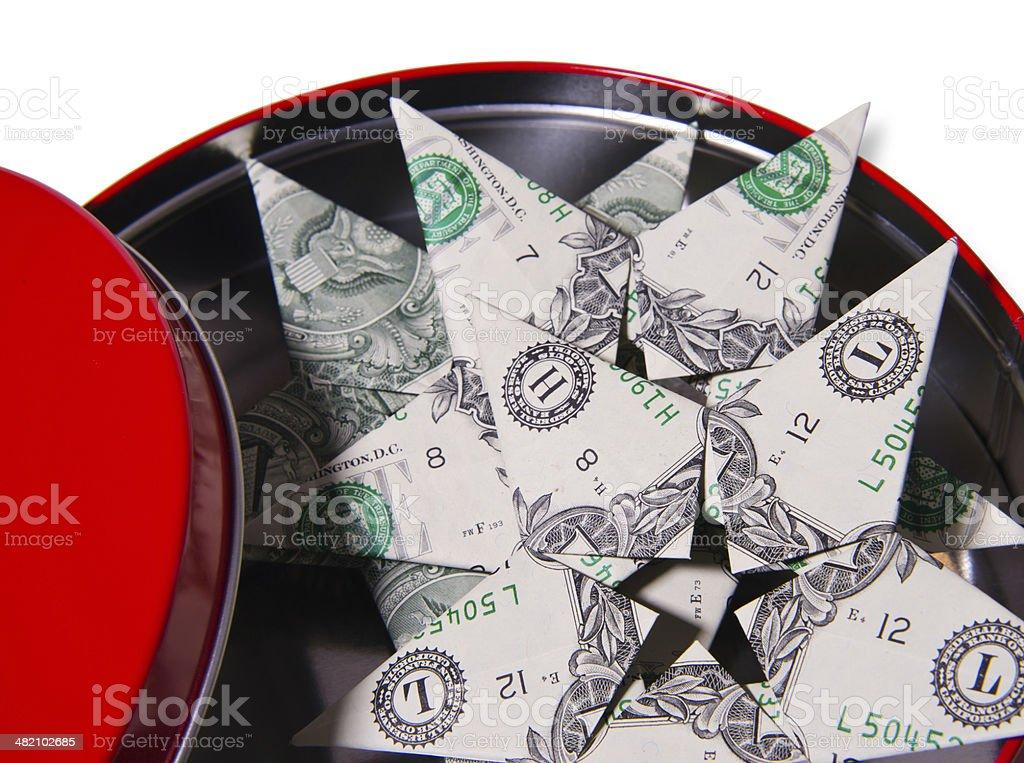Rosso scatola rotonda e banconote dollaro stelle foto stock royalty-free