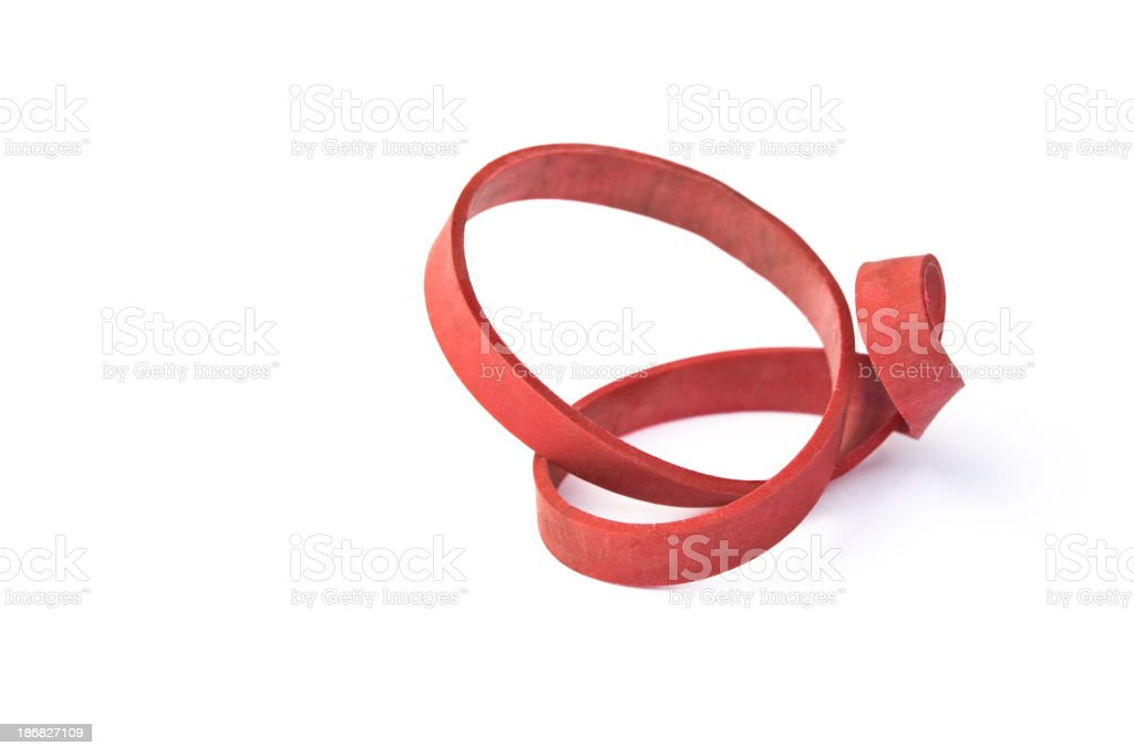 Red rubber band twisted into a topological shape stock photo