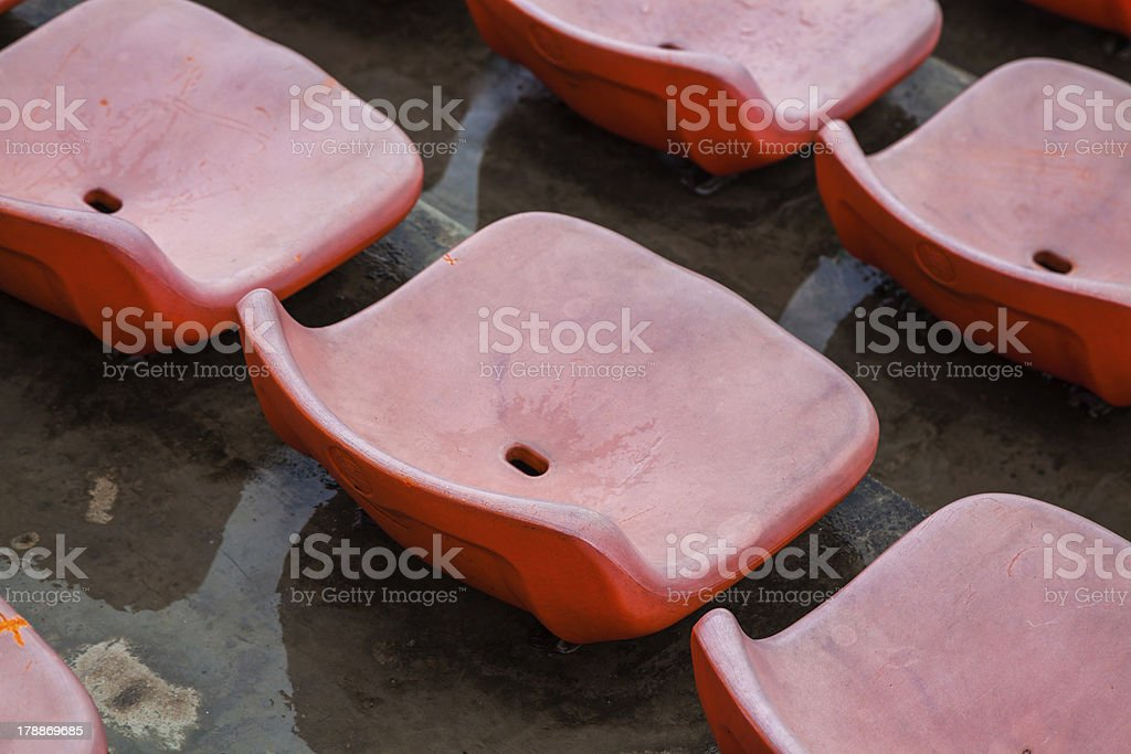 red rubber seats in track field royalty-free stock photo