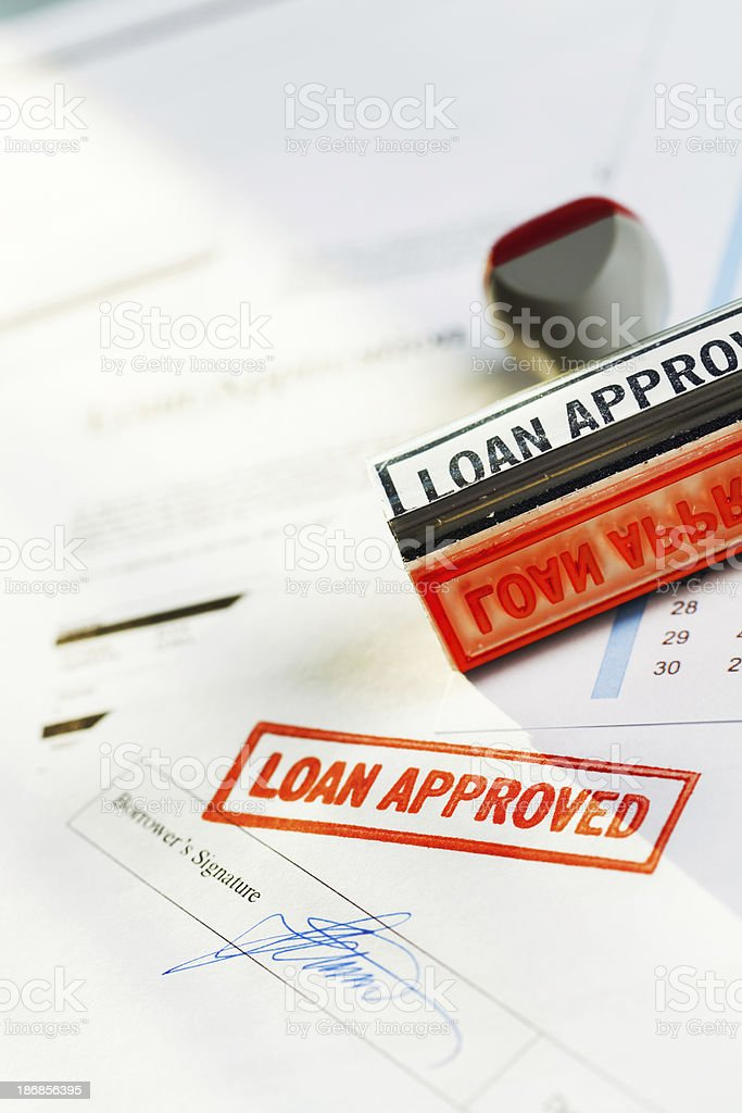 """""""LOAN APPROVED"""" Red Rubber Stamp Approving Bank Lending Application Documents royalty-free stock photo"""