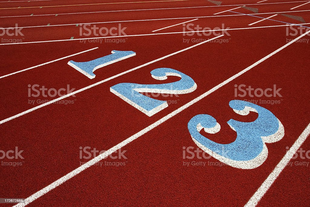 Red Running Track Lanes 1, 2, 3 with white lines royalty-free stock photo