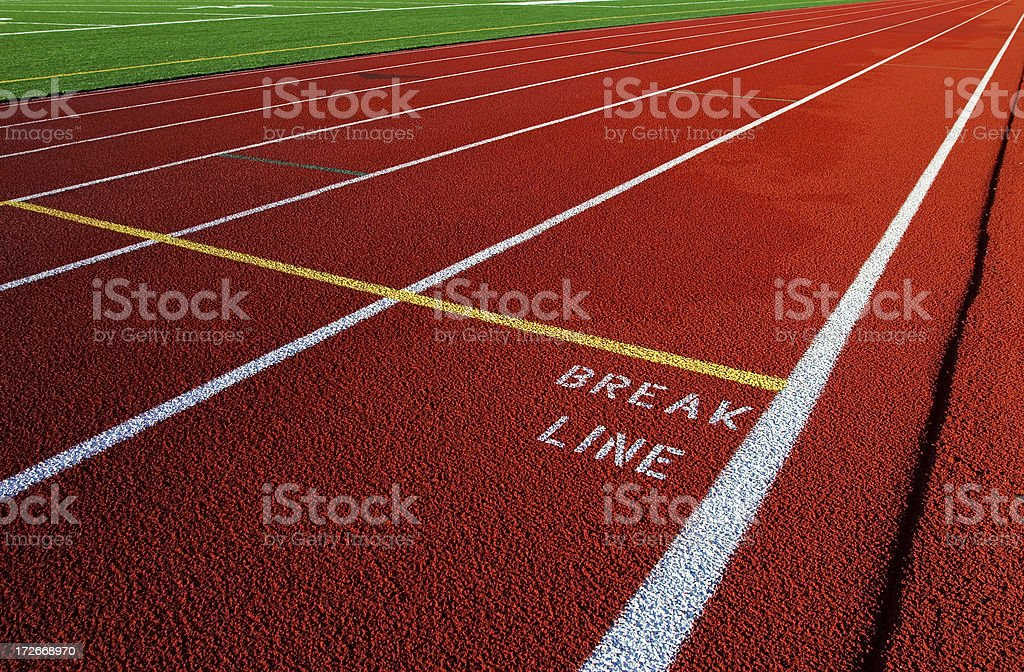 Red running track lanes and break Line royalty-free stock photo