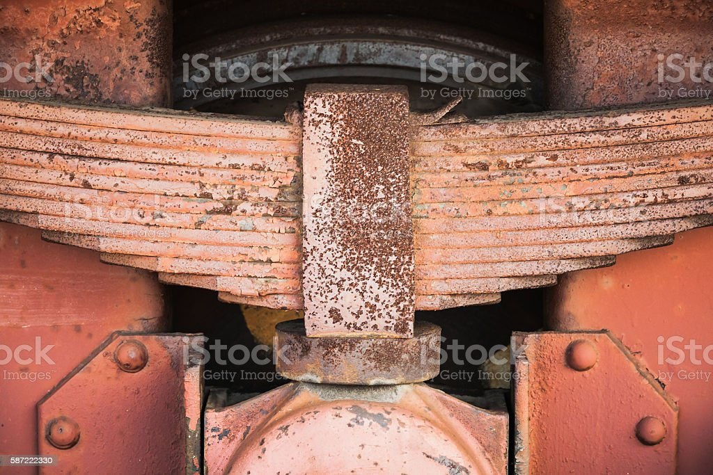 Red rusted leaf spring of industrial railway carriage stock photo