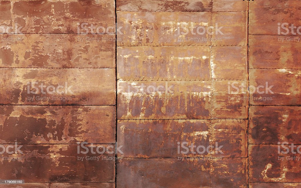 Red rusted metal wall texture with welds royalty-free stock photo