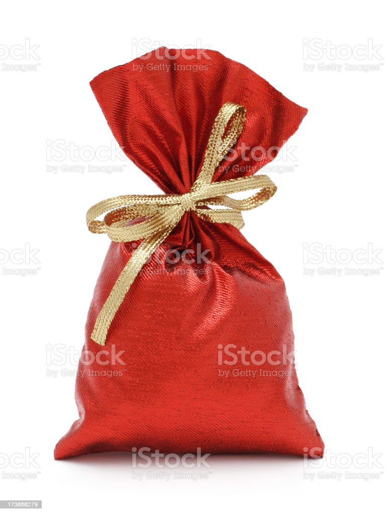 Red sack with golden ribbon full of presents stock photo