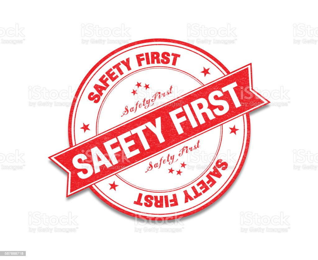 Red 'Safety First' Stamp On White stock photo