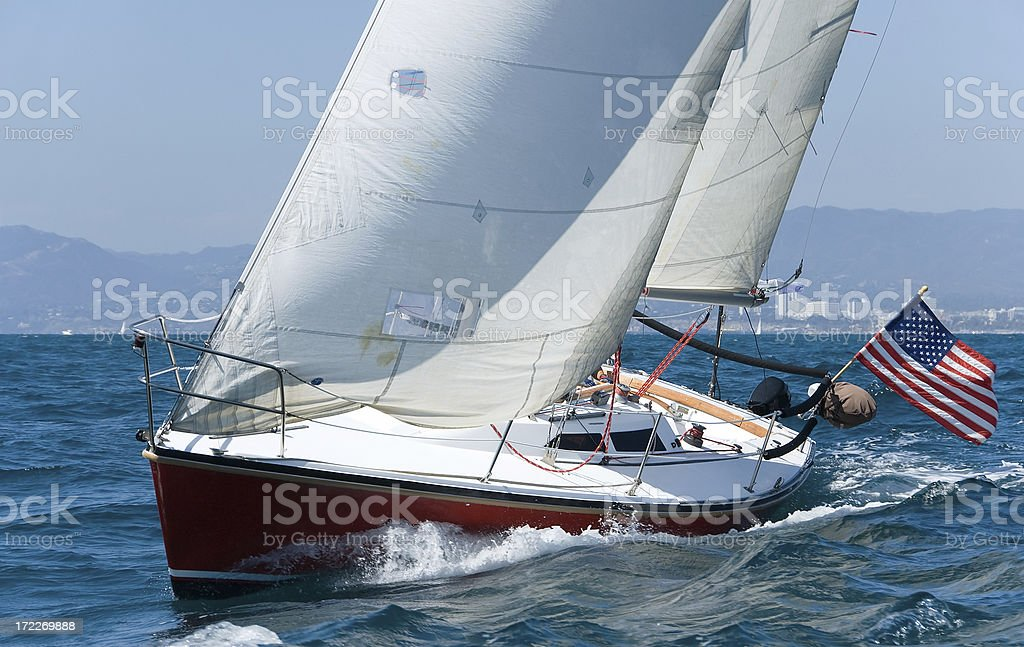 Red Sailboat Off Coast of Southern California stock photo